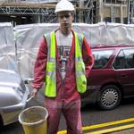 Young guy in red nylon coverall